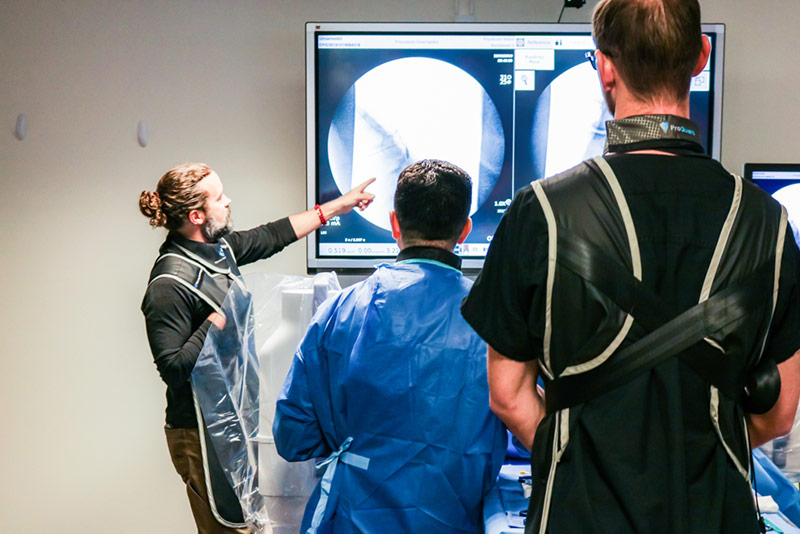 Healthcare professionals reviewing back x-ray