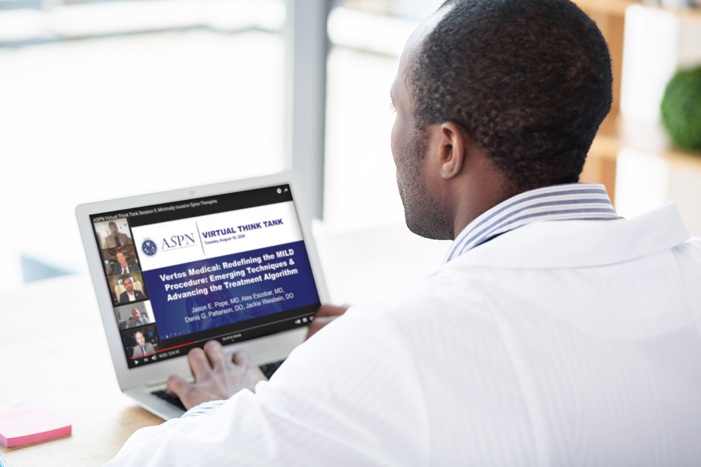 Doctor on laptop looking at continuing education opportunities with the Mild Procedure to Treat Lumbar Spinal Stenosis